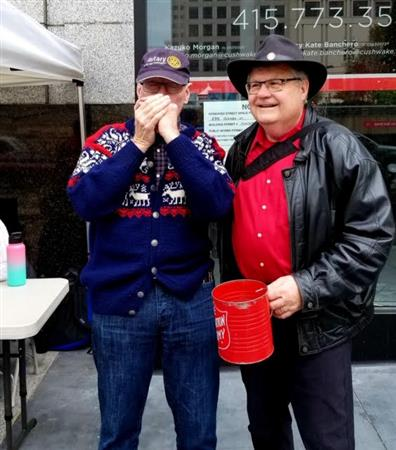 Past presidents Tim Hornbecker (on the harmonica) and David Dye at the bell ringing on Union Square on December 6, 2019