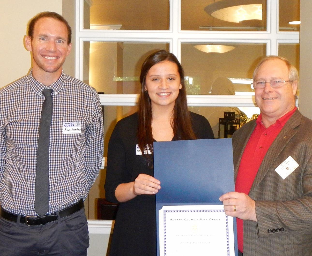 From left, Athletic Director Erick Steelman, Student of the Month Brooke Richardson, and New Generations Chair Geoff Owen.