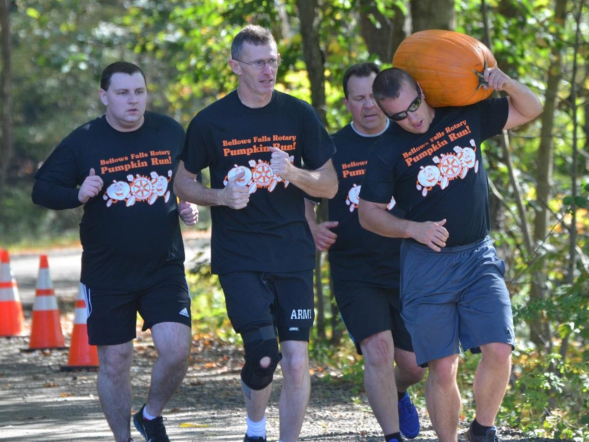 The Deputy Dawgs haul their 39 pound pumpkin to the next obstacle