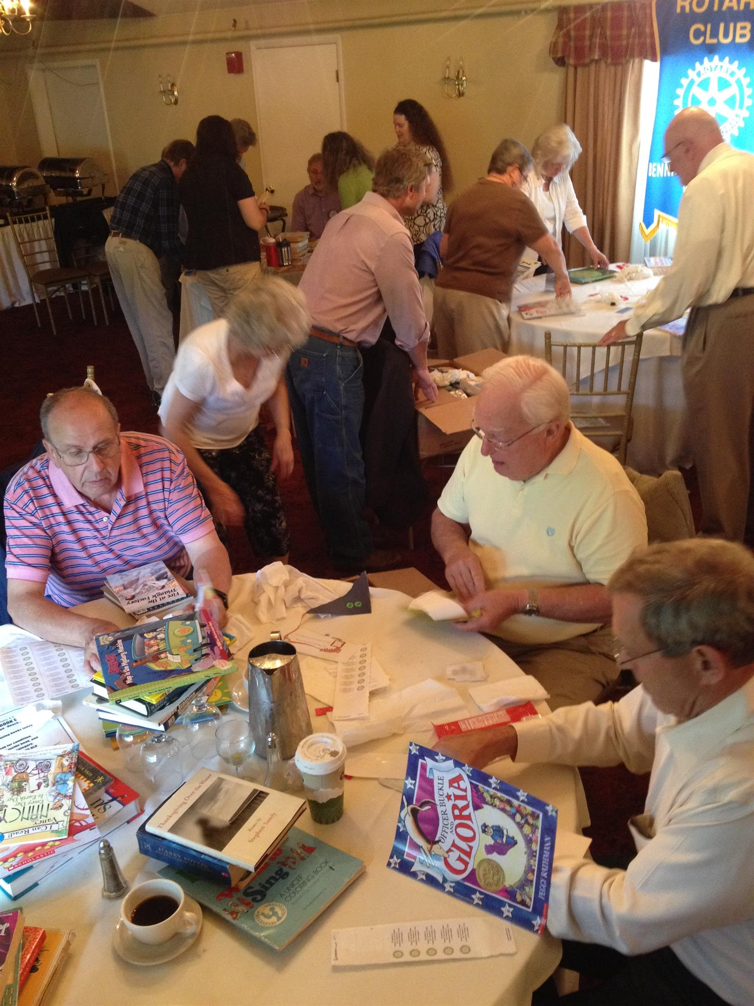Catamount Rotary members prepare books for Reach Out and Read