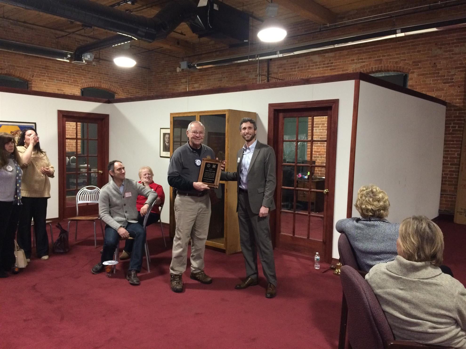 Bennington Rotary Club president Mike Nigro presents an award to Jerry Albert, who accepts it on behalf of the VFW