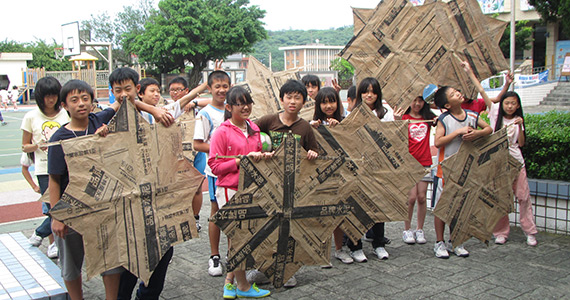 Stories rotary club of capital city sunrise concord students show off their construction skills by making kites out of newspapers during classes supported by the science education program fandeluxe Choice Image