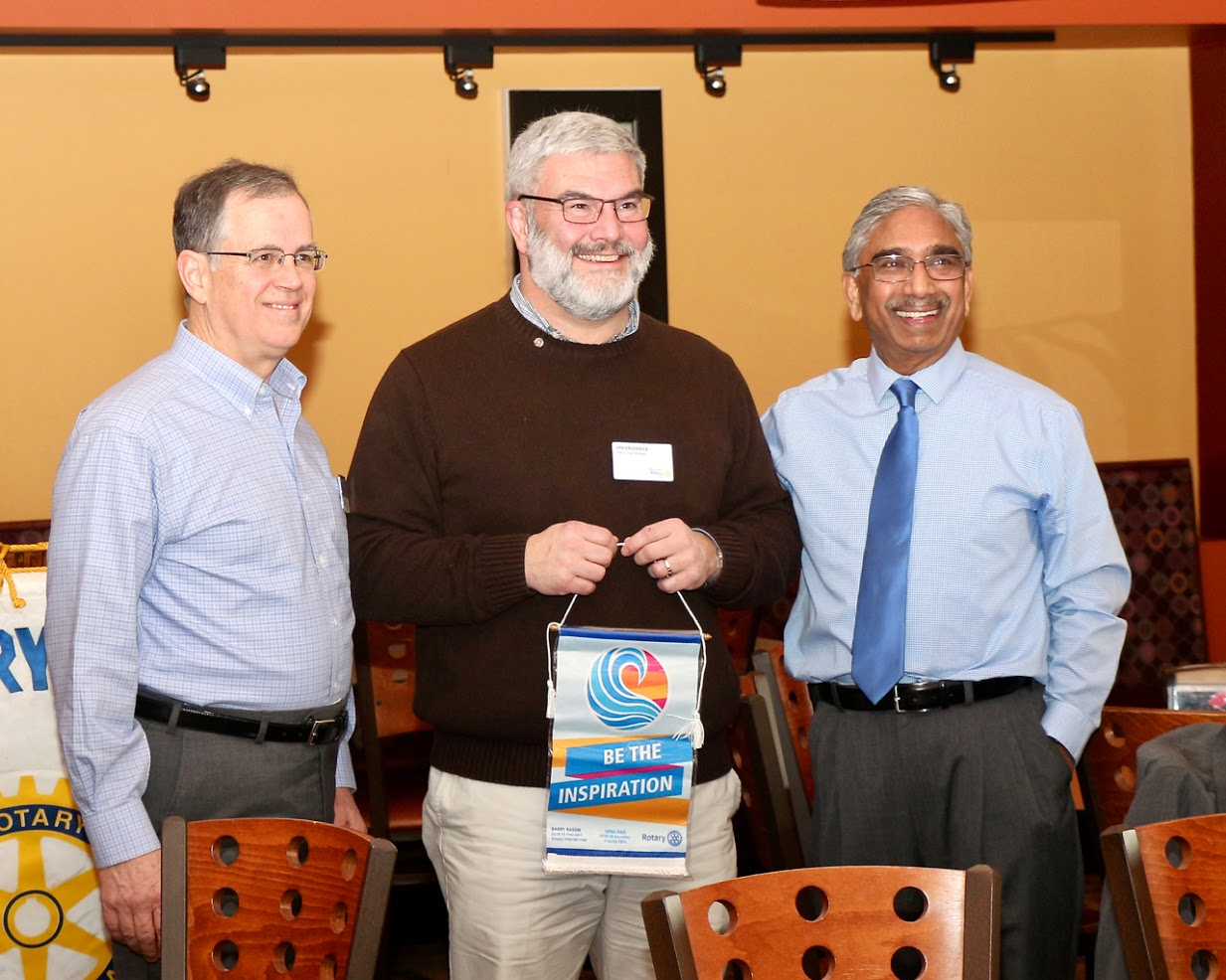 Dale Grabel, AG, and Venu Rao, District Governor, stand on both sides of  our President-elect, Jon Frederick, shortly after Venu presented Jon with a