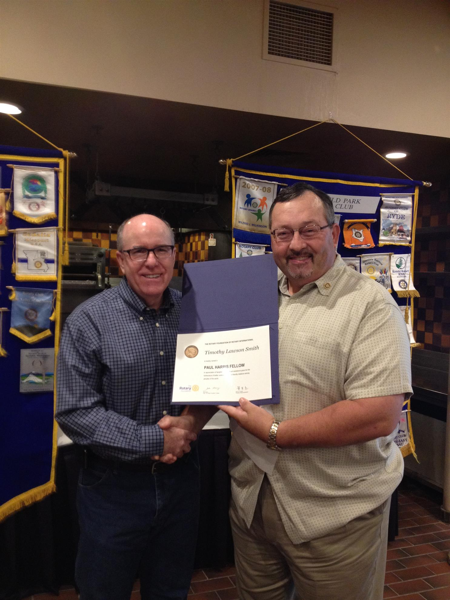 Tim Smith receiving the PAUL HARRIS Award from our current President, Tim Blake.