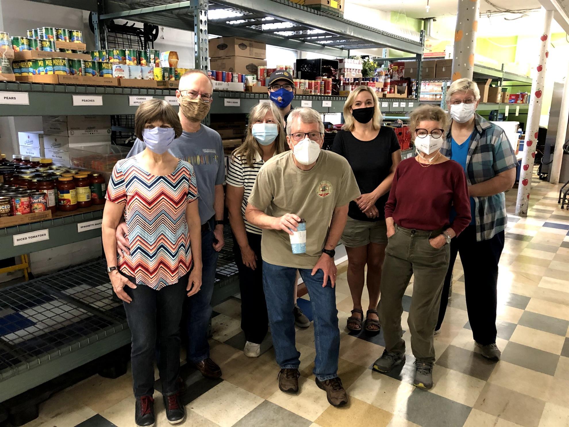8 Rotarians return to serve at CES Food Shelf