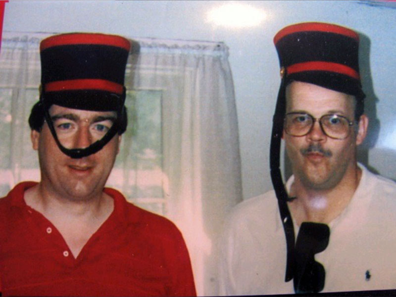 Two COL Rotarians with funny hats