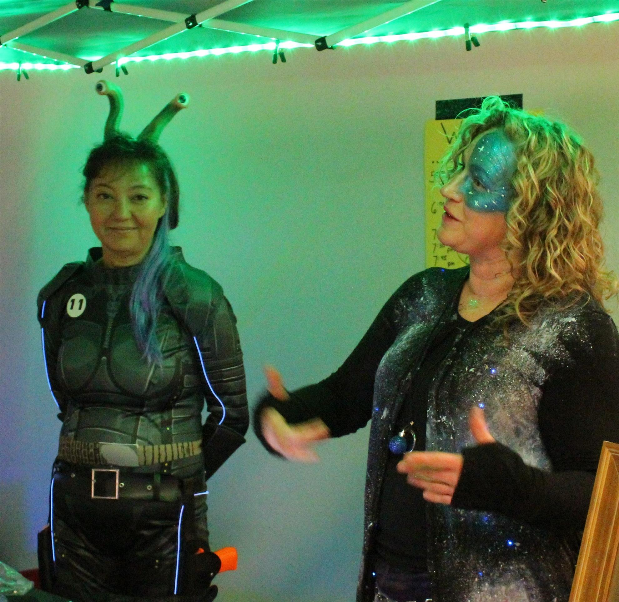 Susan Lisak and Rocky Moss checking in guests at the Sci-Fi Soiree