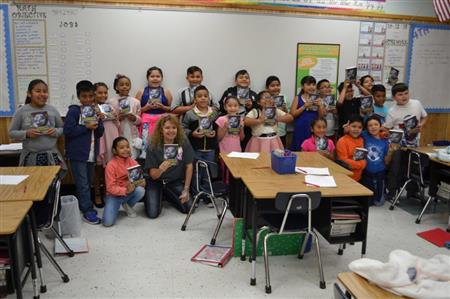 Nash 3rd Grade Students proud of their new Dictionaries