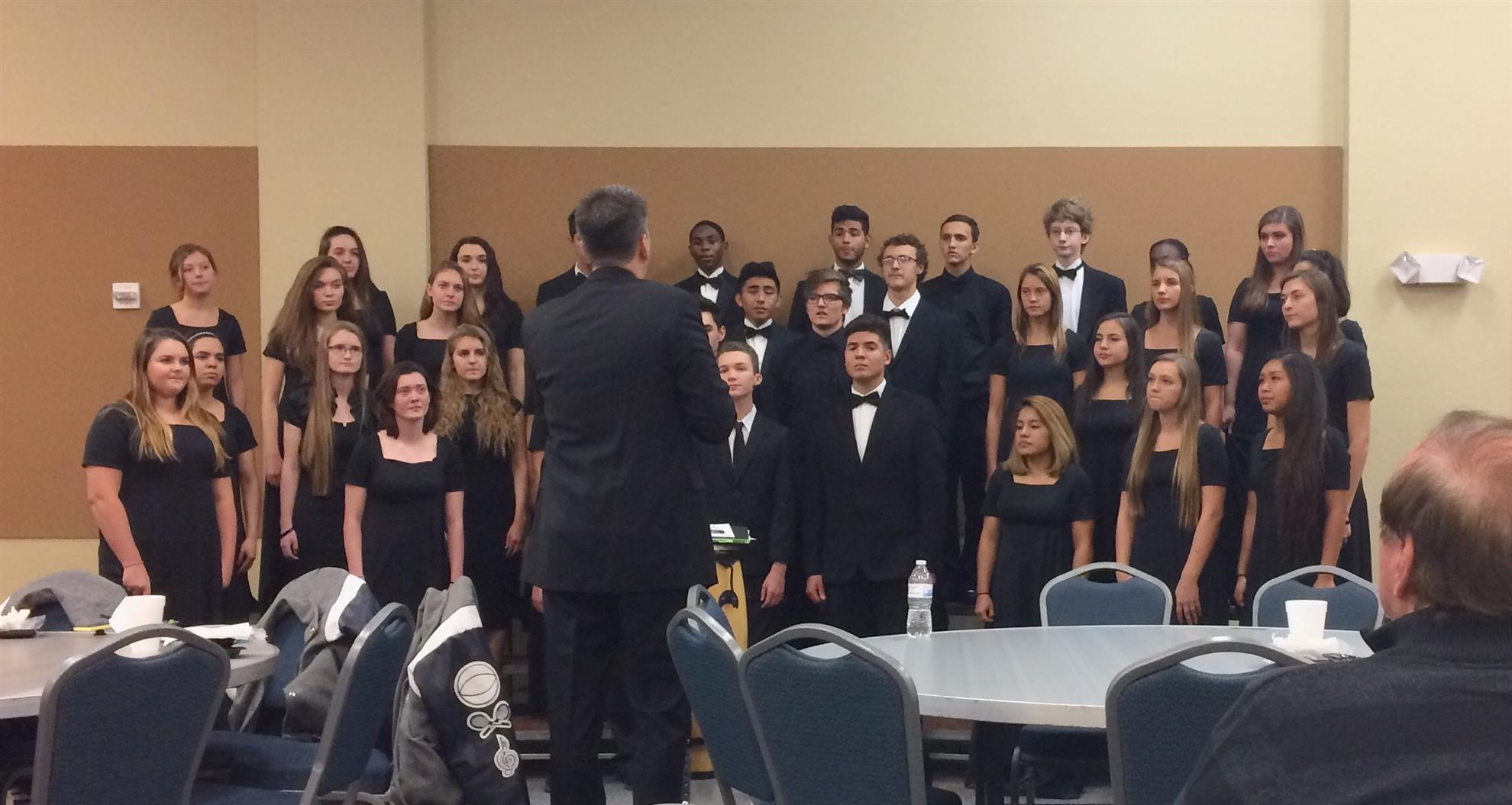 Greg Wilcox leading the Chisholm Trail Academy High School Honor Chorus