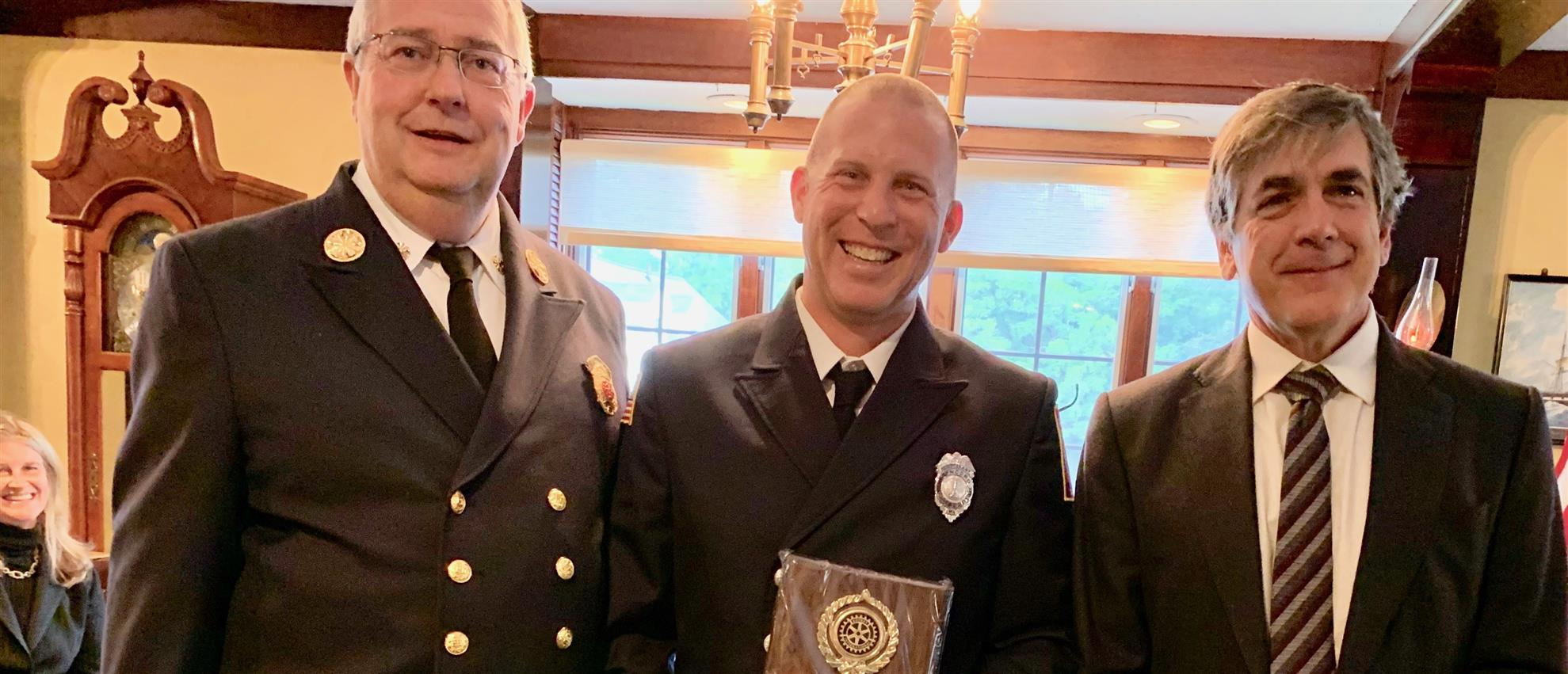 Fire Chief Tom Judge gives Al Filipov Award to Billy Nelson