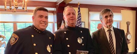 Police Chief O'Connor gives Al Filipov Award to Gerry Mearn