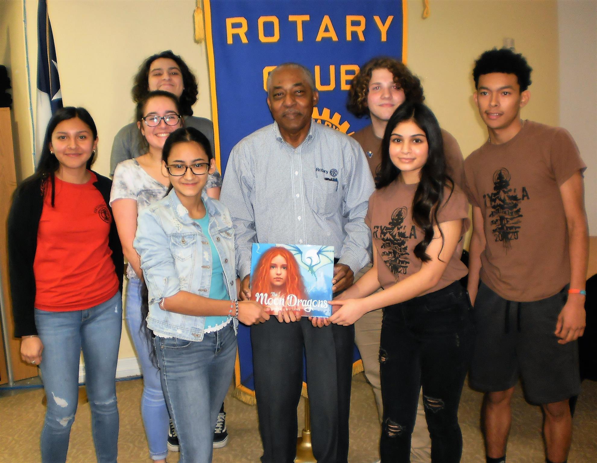 Rotary Club of EMC Board President Milton Austin and Interact Club students.