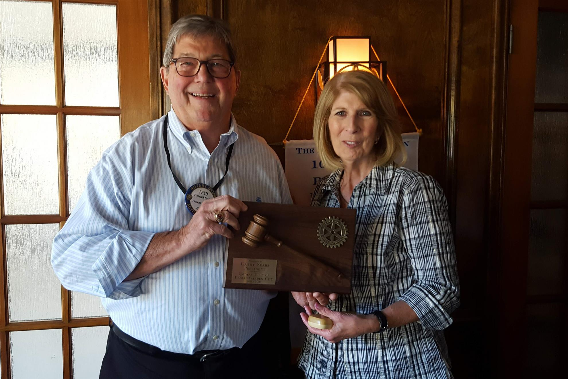 Former president Cathy Sears passing the gavel to Fred Devlin