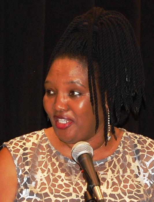 Fellow Rotarian Heather Goralski introduced Henriette Nyirarukundo Ngenga  who Is a survivor of horrific atrocities against the Tutsi in Rwanda which  began ...