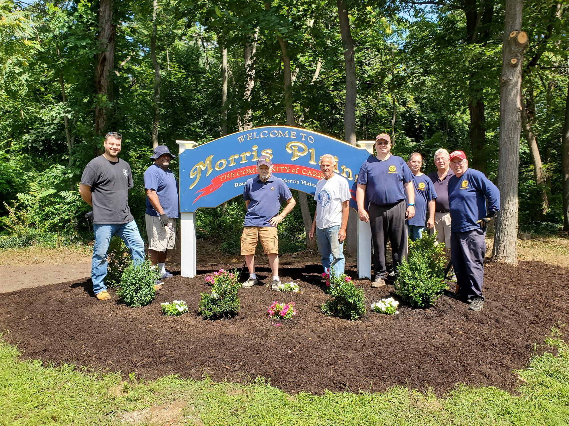 Thirteen Morris Plains Rotarians installed a Welcome to Morris Plains sign and landscaped the corner ofMalapardis Road and Johnson Road.