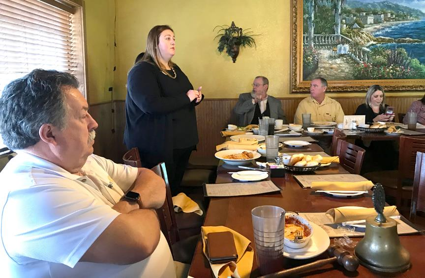 First Financial Bank of Mineral Wells Vice President Trina Richards discusses financial exploitation of seniors and the elderly at Wednesday's Rotary Club of Mineral Wells meting at Pastafina Restaurant.