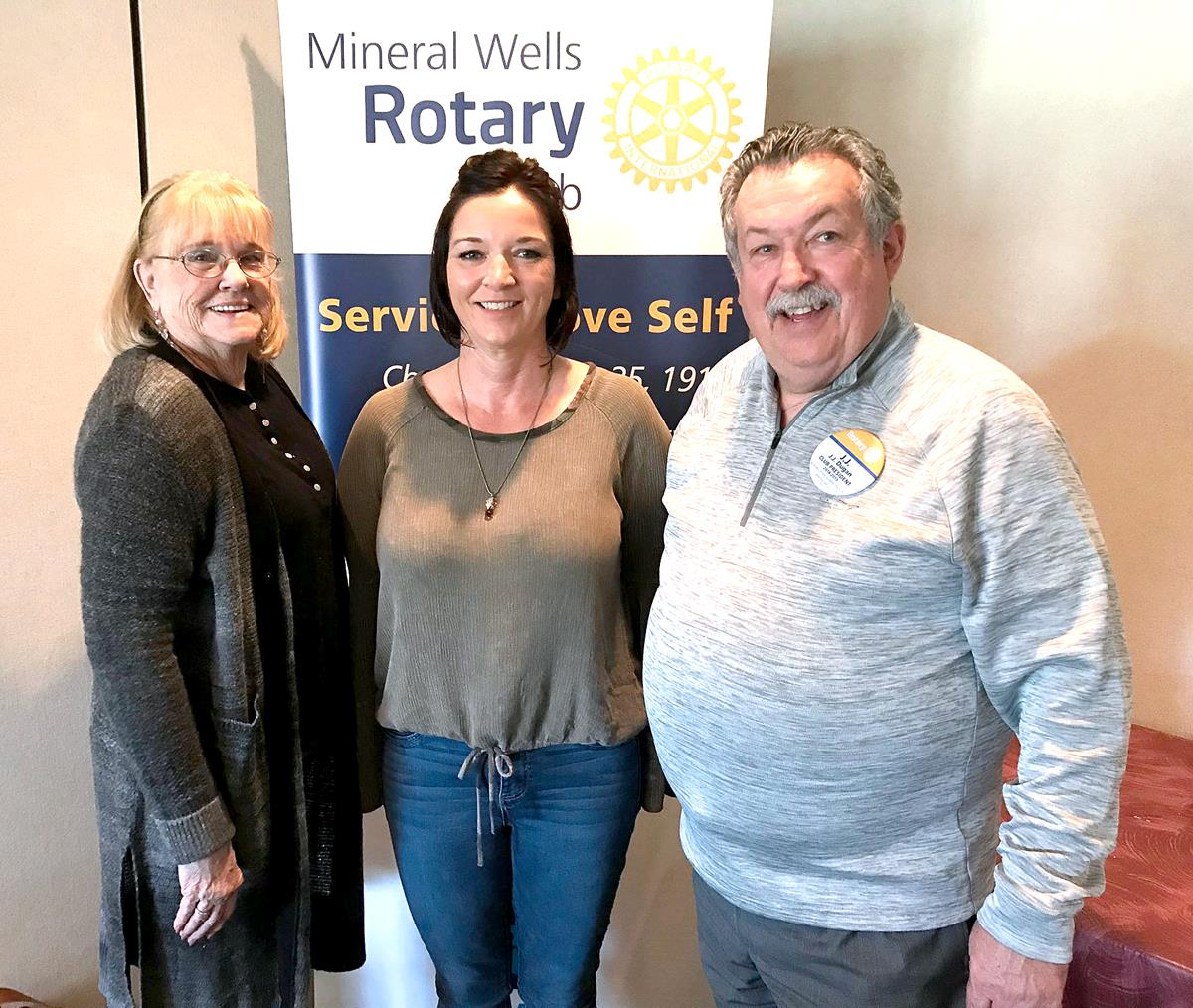 Dorothy Clark, left, and Amy O'Bannon, center, are pictured with Rotary Cub of Mineral Wells President JJ Dugan. Clark and O'Bannon gave a presentation on the benefits of their lines of Texas-legalCBD products.