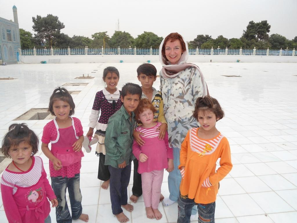 Susan Weidner with children at Blue Mosque Mazar I Sharif