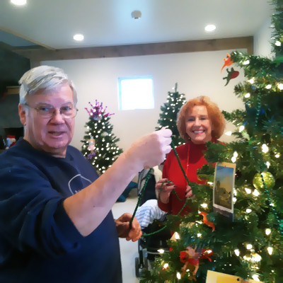 McGuire and Lambros decorate tree