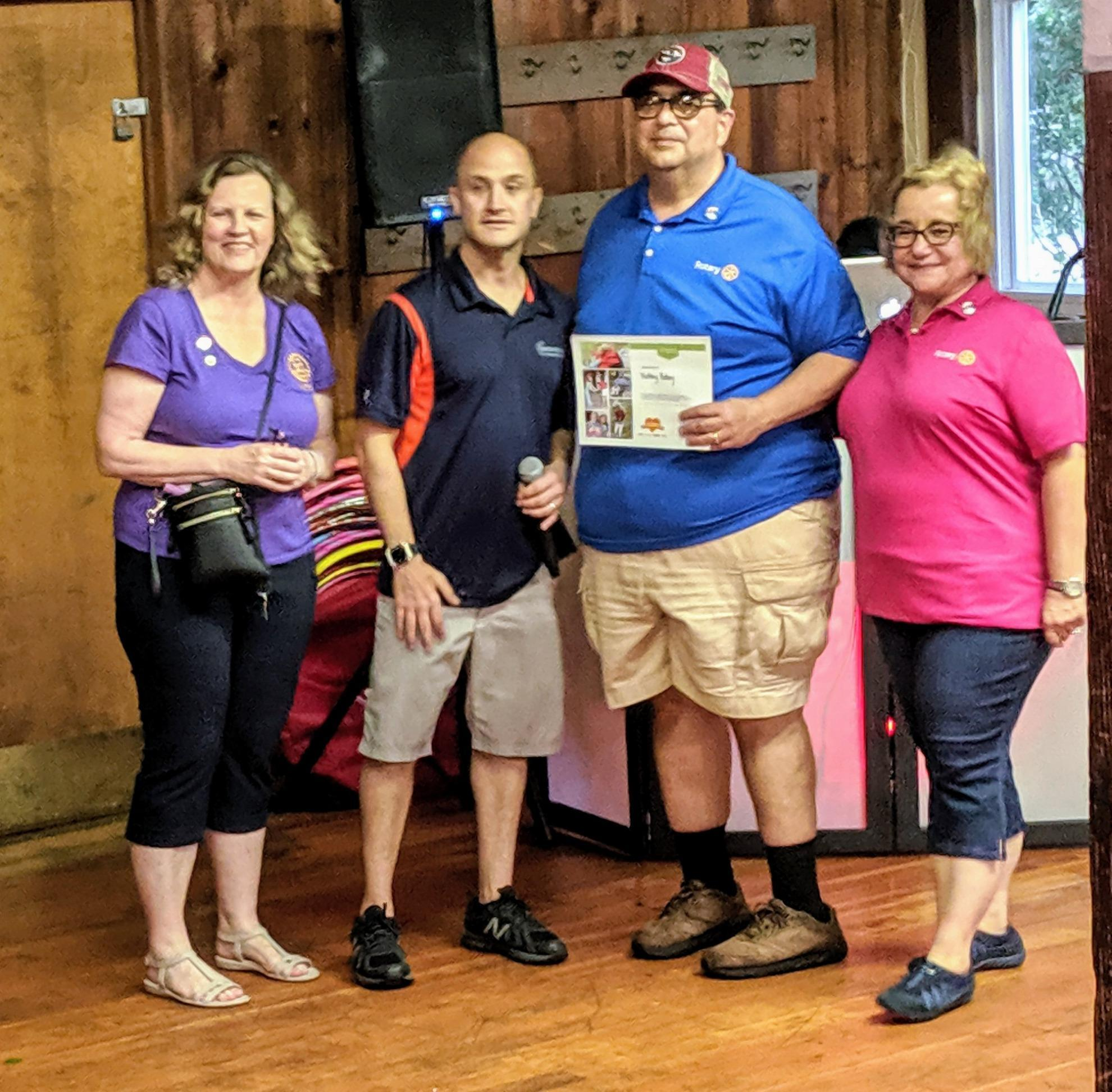 Merry Heart Camp Awards: President Ben Costa, immediate past President Ro Costa, President Elect Dorothy Huey and Camp Director Dave