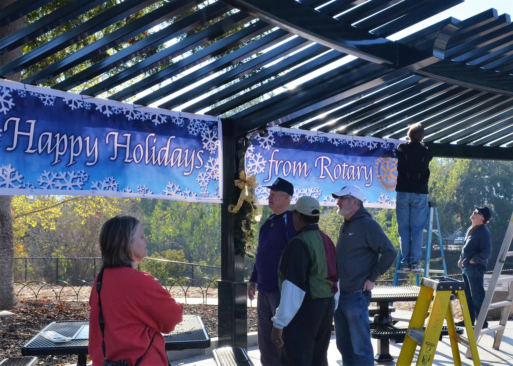 Rotary Club of Pleasanton and Pleasanton North Rotary joined forces Nov. 14 to decorate Rotary Park on Main Street for the holidays.  From left: Lara Golden, Brad Hirst, Don Lewis, Frank Hanna, Scott Raty and Larry Annis.  Photo by Jim Brice