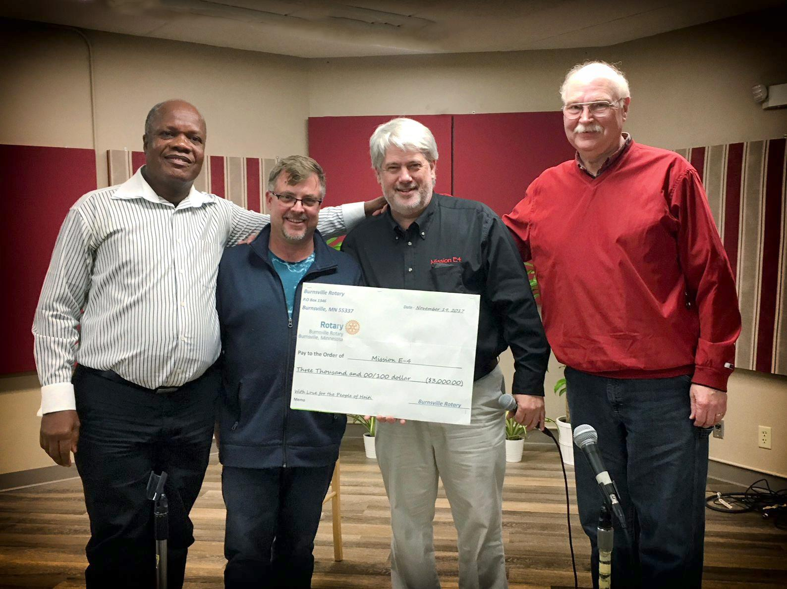 Burnsville Rotary presents check to Mission E-4