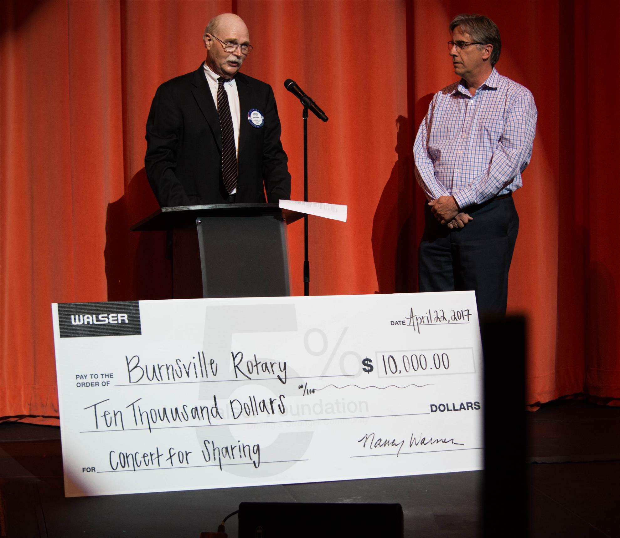 Burnsville Rotary receives check from Walser for Concert for Caring