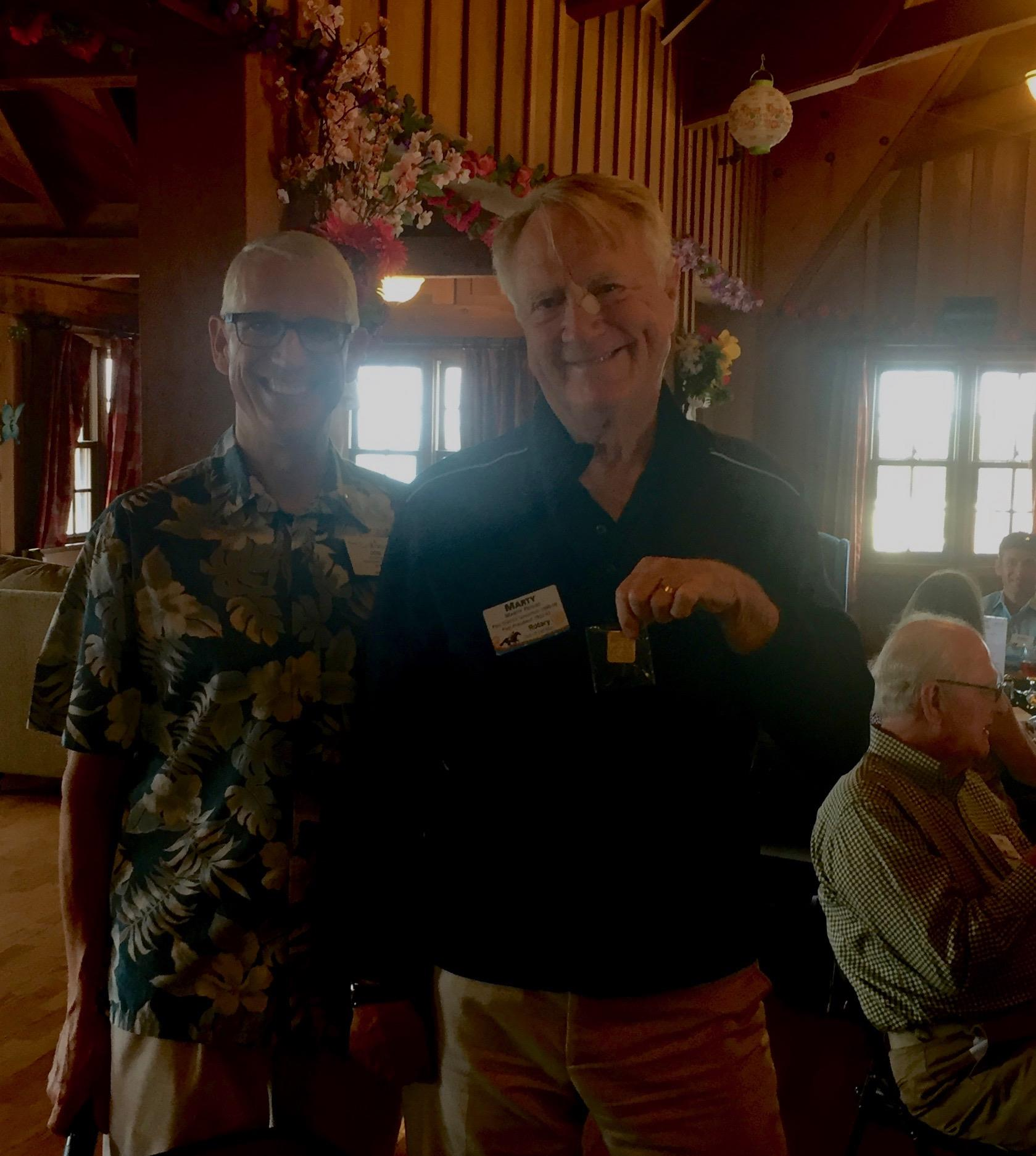 74e69df2ac Don Fipps (left) and Marty Peters (right) holding his Triple Crown Donor pin