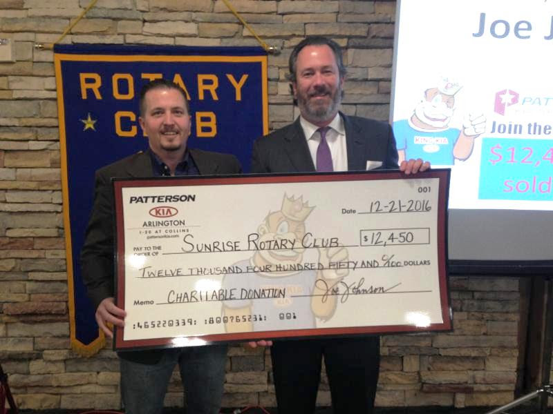 Joe Johnson (r), Managing Partner Of Patterson KIA, Presents Sunrise  President Colby Van Sickler (l) With A Check For $12,450 For Our Phased In  Project.