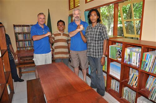 Rotarians with builder in refurbished library
