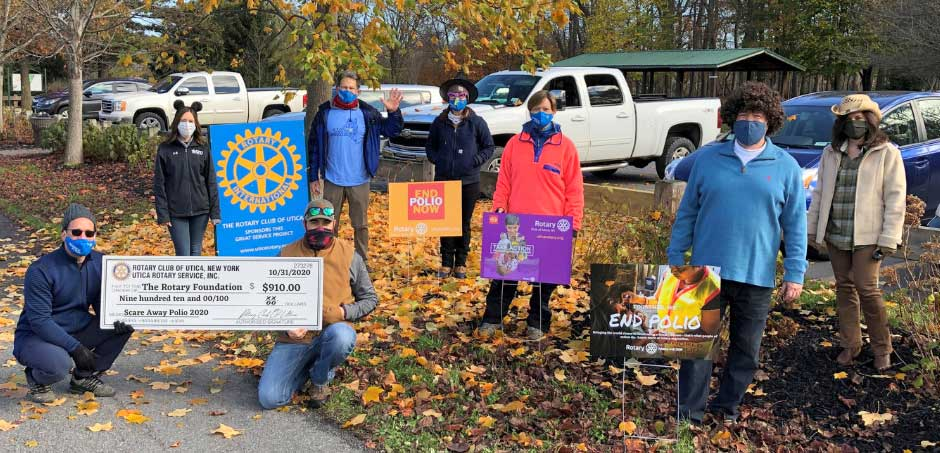 Rotarians pose with signs during 'Walk to Scare Away Polio'