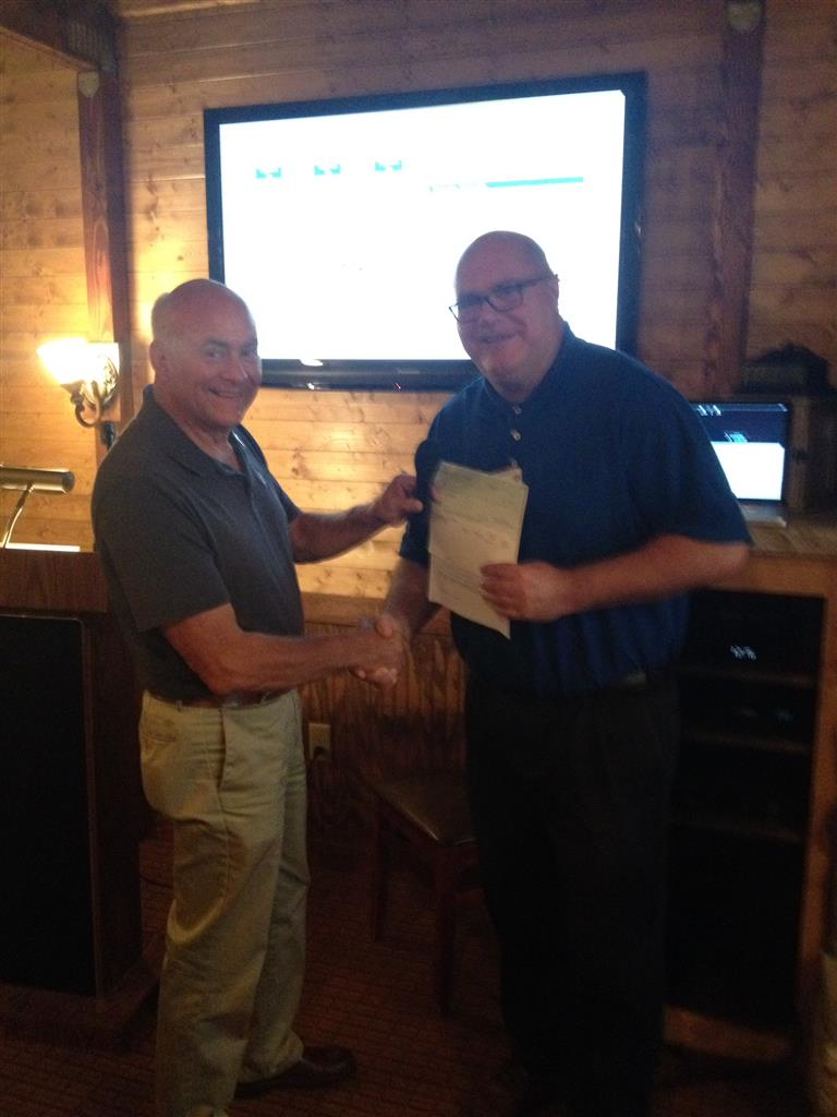 Guy Selinske (Prior Lake Rotary) presents district grant check to John Wollersheim (Rosemount Rotary)