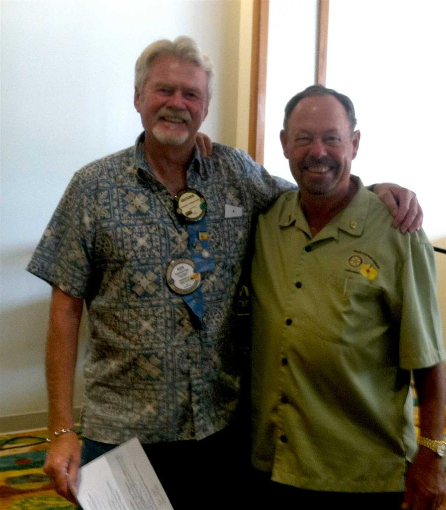 Acting President of Rotary Club of Kona, Alan Clark, presenting the check to Rotary Club of Kona Community Foundation President Ken Kjer