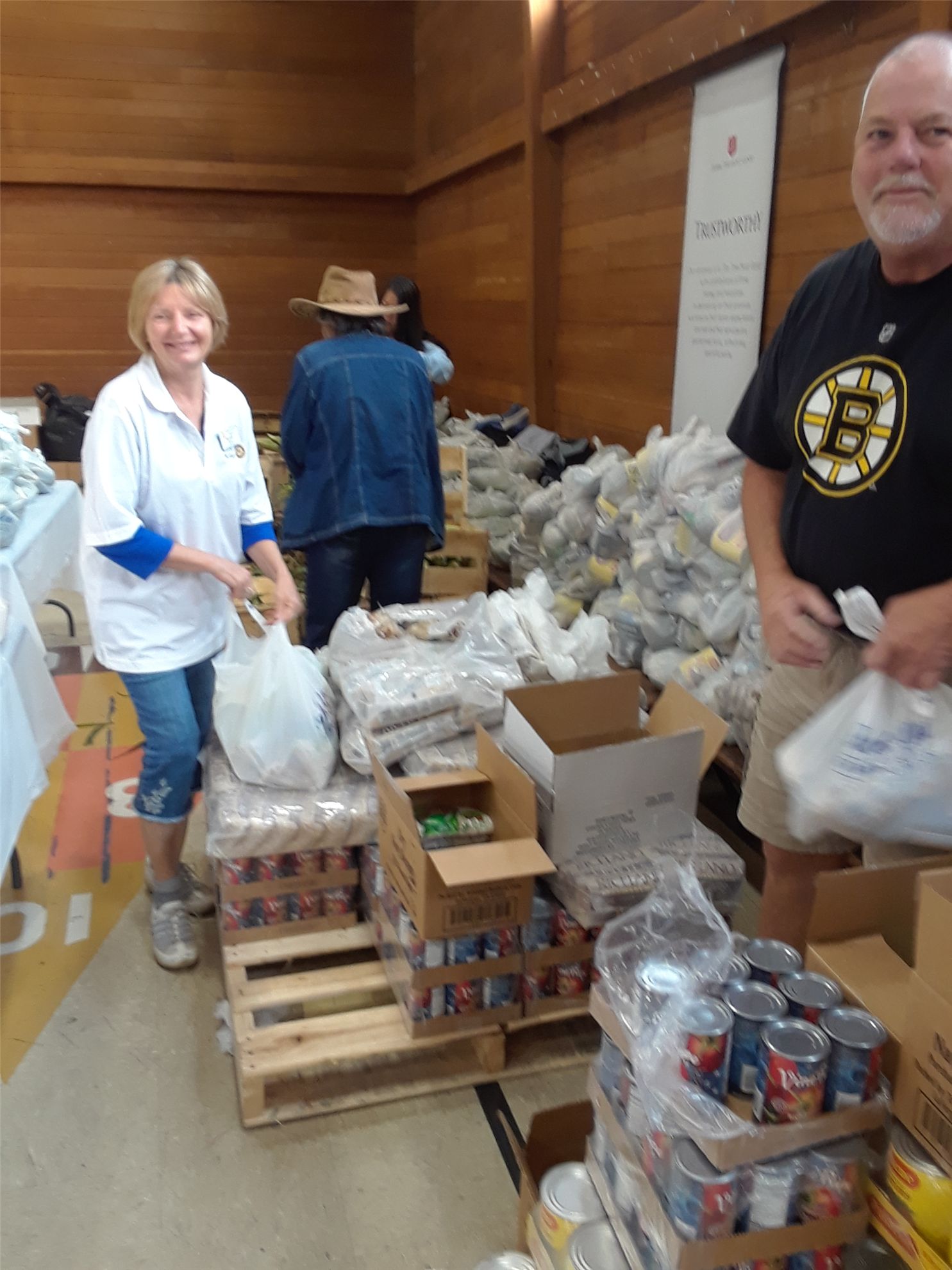 Kathy Gupta and Paul Price bagging items for distribution