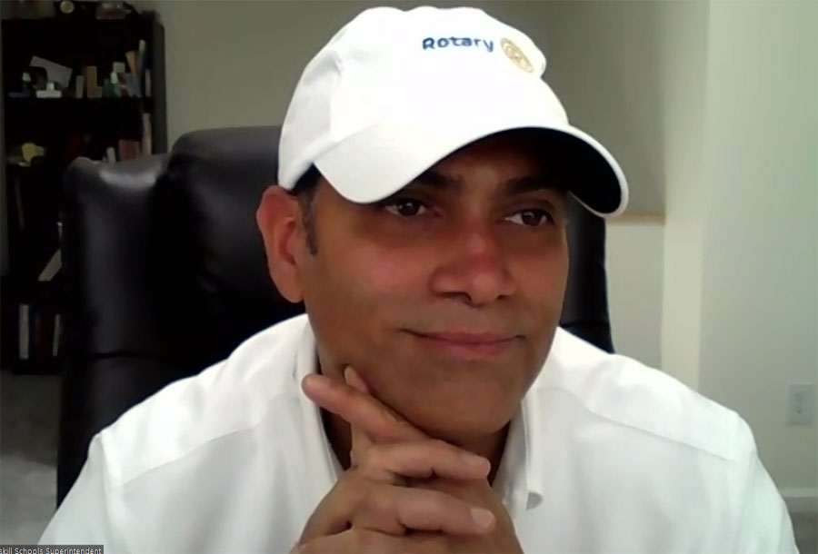 Dr. David Mauricio wearing his new white Rotary hat.