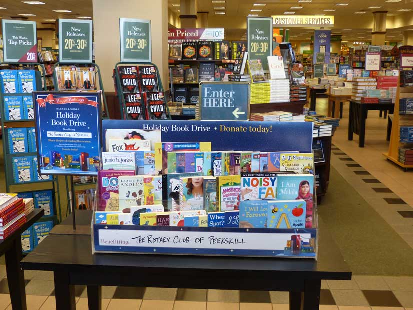 2017 Holiday Book Drive table inside Barnes & Noble
