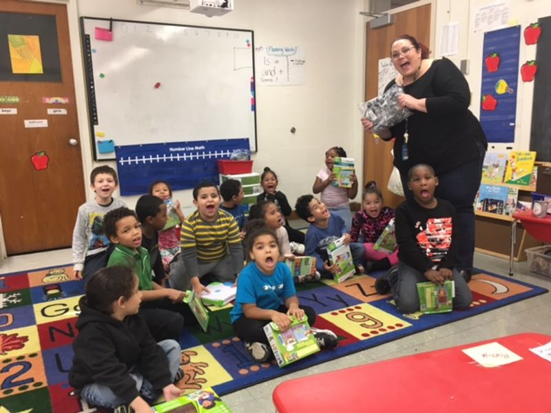 Mrs Montoya hands out Leap Frog Readers