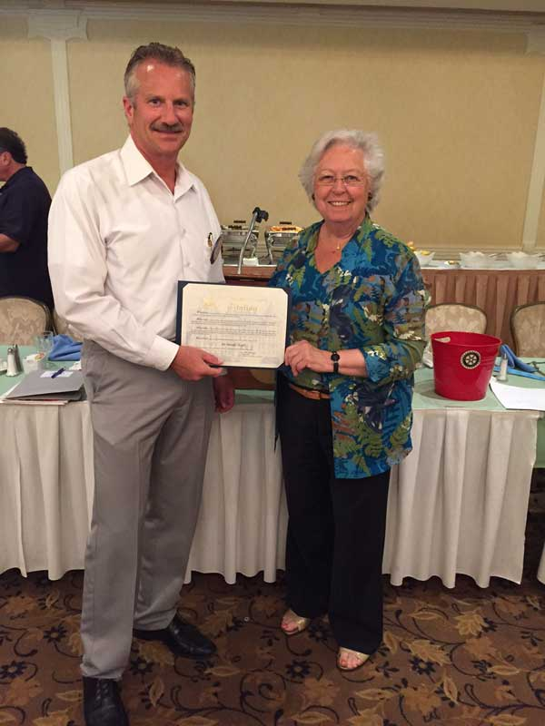 Ron Worth accepts award from Assemblywoman Sandy Galef