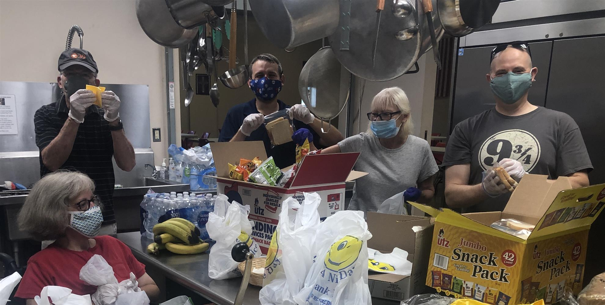 Rotarians pack lunches for the homeless at the Salvation Army Bethlehem location.