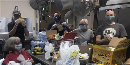 Rotarians pack lunches for the homeless at Salvation Army's Bethlehem location.
