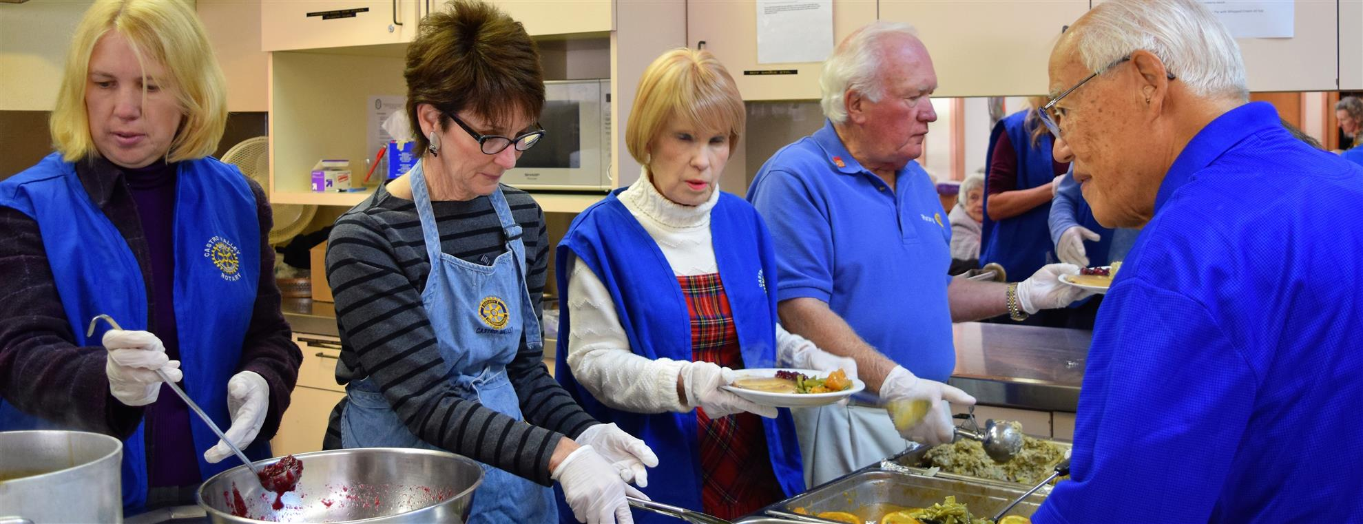 Rotarians Serving the H.A.R.D. Senior Thanksgiving Lunch