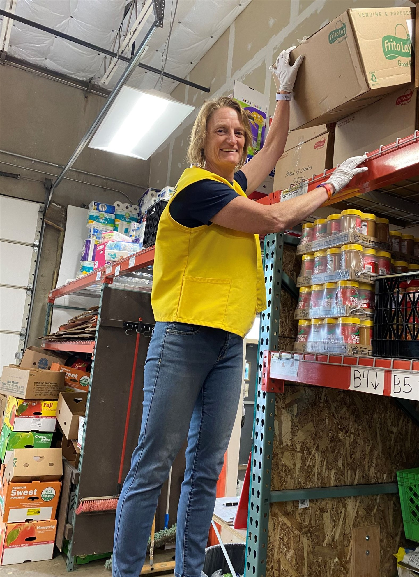Rotarian Sharon Sjostrom volunteering at the Help and Hope Center Food Pantry