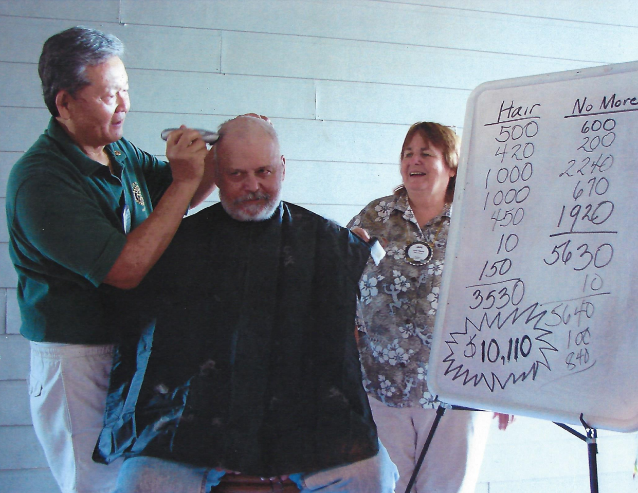 Alan Okinaka shaved Jay Curlee's hair at the Yacht Club