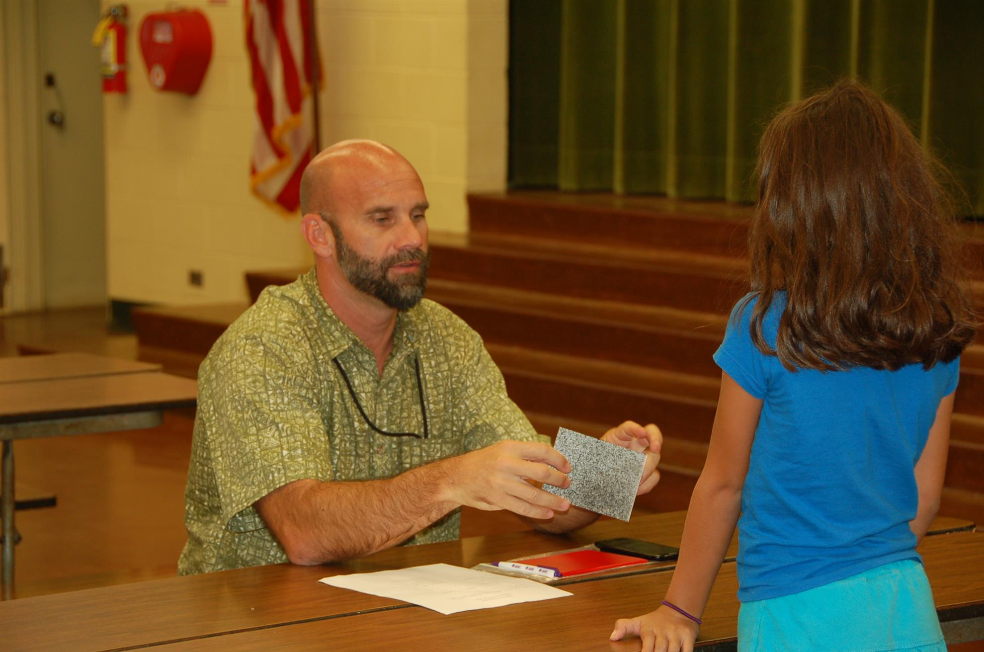 Kane with 3rd Grader getting ready for a Keiki Vision Test