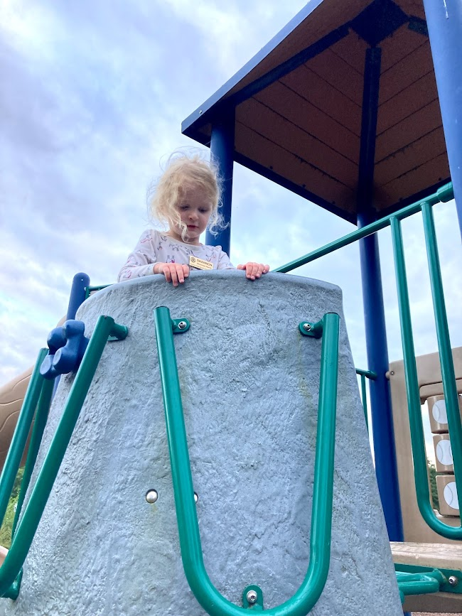 Shannon in pouch at King's Bend Park playground