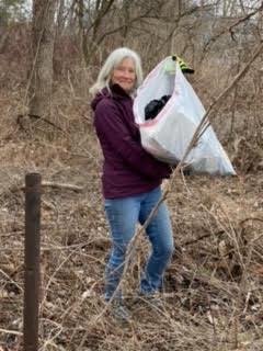 Rotarian Ginny collecting trash