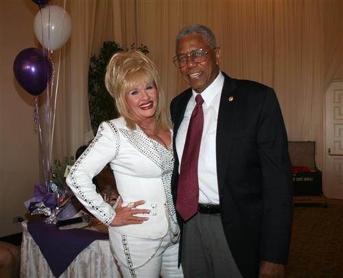 Dolly Parton impersonator and President Nat Trives