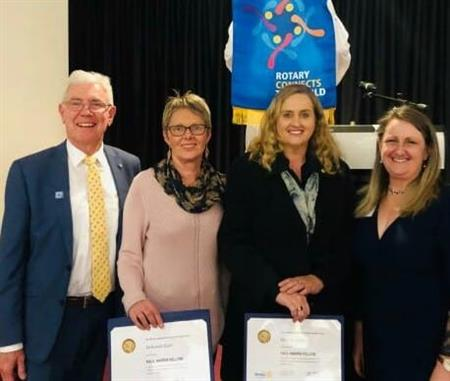 Incoming President Brian Middleton with Deb Earl and Wendy Coffey, both Paul Harris Fellow recipients, with outgoing President Michelle Miller to the right