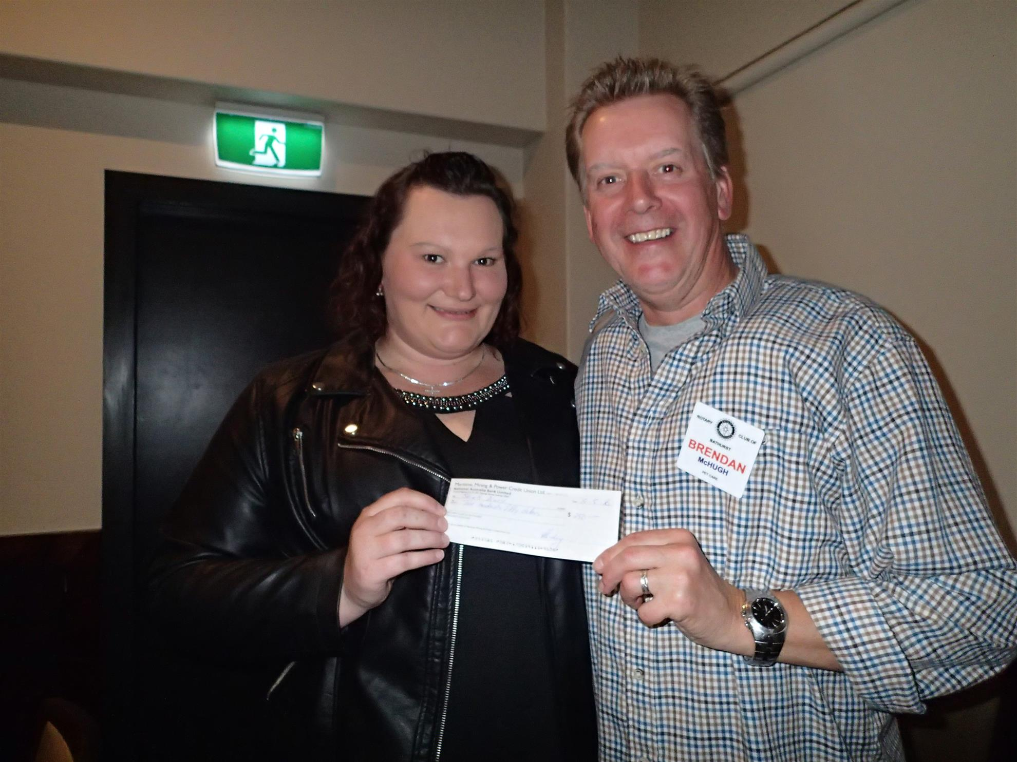 President Brendan presented Sarah with a cheque.