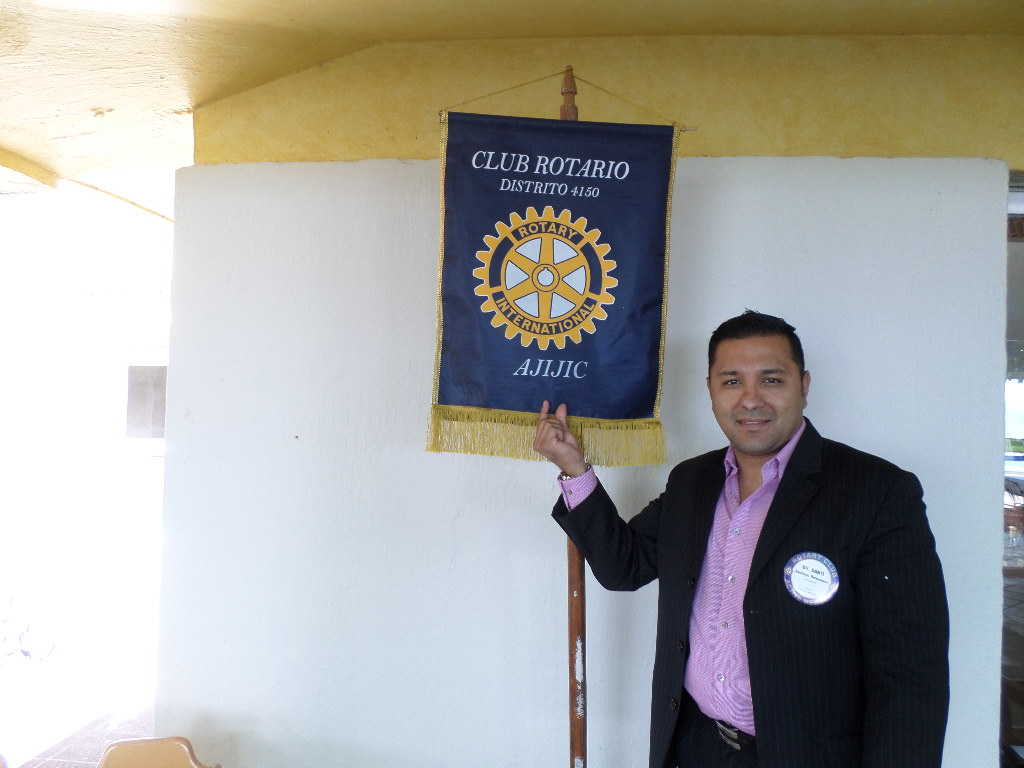 "At a recent meeting commemorating World Polio Day (October 24), members of the Rotary Club of Ajijic learned about the similarities of the Polio virus and Ebola. Rotarian Santiago R. Hernandez, Medical Director and Owner of the Chapala Med Clinic, was the speaker, referring to the Ebola virus that is currently causing panic worldwide. Dr. Hernandez explained to fellow members and guests that the Polio virus is equally as dangerous to mankind.   ""In the United States, the 1952 Polio epidemic became the worst outbreak in the nation's history. Of nearly 58,000 cases reported that year 3,145 died and 21,269 were left with mild to disabling paralysis. Paralysis occurs in only about 0.1 percent of all poliovirus infections, but such an infection can lead to respiratory depression and for those old enough to remember can bring to memory the images of children laying in their IRON LUNGS. The Polio virus shares many similarities with other viral infections during its infectious course. Poliovirus is transmitted by fecal-hand-oral contamination. During epidemics, it also may be transmitted by pharyngeal spread. Ninety to 95 percent of poliovirus infections are asymptomatic. There is NO TREATMENT or CURE for Polio, not even an experimental one as is the case for Ebola.  However, vaccination against Polio has had a profound effect. The last case of endemic, naturally occurring poliomyelitis in the United States was reported in 1979. The last such case in the Western Hemisphere was reported in Peru in 1991. The only known wild poliovirus infections in the Americas after 1991 were imported cases. The basis of the Global Polio Eradication Initiative, initiated in 1988, has been immunization and surveillance. The results have been dramatic. In 1988, Polio was endemic in more than 125 countries, and paralyzed at least 350,000 children per year. By 2011, the number of cases of acute flaccid paralysis due to poliovirus was reduced to 650. By 2012, there remained only three countries in which endemic wild poliovirus transmission had never been interrupted: Afghanistan, Nigeria, and Pakistan. Despite this progress, new outbreaks of Polio continue to occur, and the World Health Organization declared in May 2014 that the spread of Polio had become a global public health emergency, posing a major threat to the global eradication effort. These outbreaks highlight the risk for wild poliovirus reintroduction due to a combination of international travel, health systems with limited resources, areas of low oral poliovirus coverage, and delays in recognizing and testing cases of acute flaccid paralysis. These risks are exacerbated in areas of military, political, and social conflict, such as Syria and Pakistan. The Global Polio Eradication Initiative partnership was launched in 1998 and is led by five organizations: the World Health Organization (WHO), the United States Centers for Disease Control and Prevention, the United Nations Children's Fund, Rotary International, and the Bill and Melinda Gates Foundation. The partnership includes numerous governmental and non-governmental donors and the ministries of health of all affected nations who plan and carry out the program's initiatives at an overall cost that exceeds $1 billion per year. The global eradication program is based on four strategies: routine infant immunization, supplementary immunization campaigns in many middle- and low-income countries, surveillance for acute flaccid paralysis (AFP), and mop-up campaigns.""   Dr. Hernandez: ""I believe that, although Polio may not cause the same dramatic signs and symptoms in the same rapid manner as a hemorrhagic virus such as Ebola, it is equally if not more important that we address its eradication in a very pro-active manner.  ""WE ARE THIS CLOSE!""   Polio still cripples thousands of children around the world. To help wipe this disease off the face of the earth forever, the Rotary Club of Ajijic is holding its 5th Annual Fundraising Dinner on November 8 from 5.00 - 8.00 p.m. at Roberto's Restaurant, proceeds of which go to the Rotary Foundation Stop Polio Fund and will be matched 2 for 1 by the Melinda and Bill Gates Foundation. For tickets and information contact Anita Hocker at ganitahocker@gmail.com or call 376 766-2410."